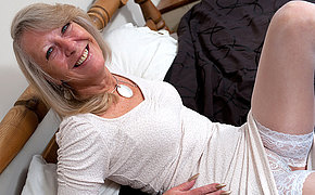 Blonde granny teases her cunt