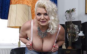 Chubby mature slut showing off her firm tits
