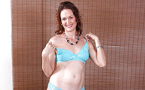 Cute American housewife loves playing alone