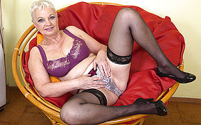 Horny mature slut playing in her chair