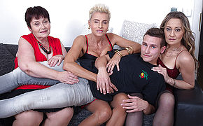 Three mature sluts share one hard cock in a foursome