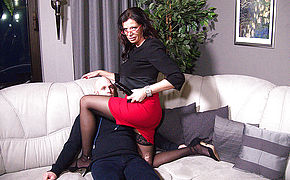 German mature mistress fucking a guy up the ass with a strapon
