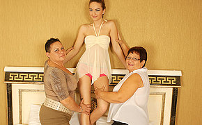 Three stunning granny and teen lesbians go hardcore on bed
