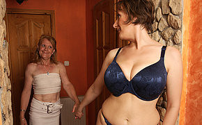 Two stunning MILF lesbians humping and then kissing