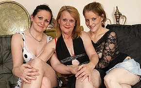 Three mature and young lezzies go at it on the bed