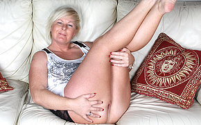 Sweet blonde MILF playing on the sofa