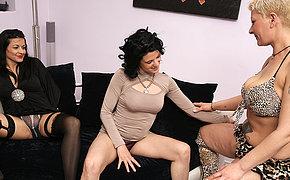 Three sexy mature and teen lezzies banging eachother on the sofa