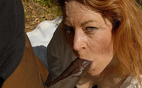 Redhead mommy enjoys swallowing cum from ebony dick