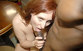 Hot redhead getting fucked with a huge black dagger
