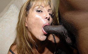 Marvellous mommy enjoys those two ebony dicks