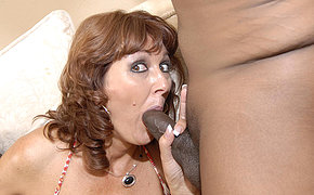 Sexy spouse doing blowjob to two ebony dicks