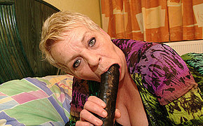 Hot European mommy masturbates with her sex toy