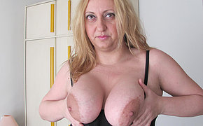 Fat slut with big breast  teases a sex toy
