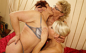 Two vicious MILF chicks take on a sexy young babe