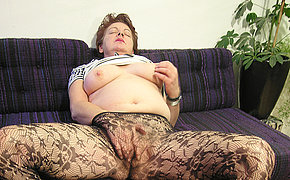 Horny granny rides a glass bottle