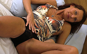 Awesome mature fingering her soaking pussy on her bed