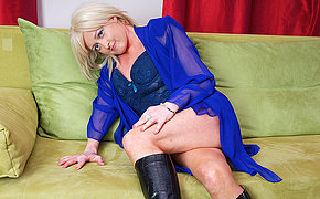 Stunning blonde mom touching on the bed