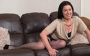 Unshaved British mature playing with her pussy