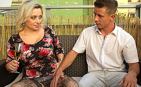 Awesome MILF with white hair is flirting with her powerful lover on the sofa