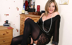 Extremely wonderful MILF is demonstrating her tremendous stockings