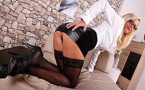 Luxurious blonde wearing glasses is showing her exciting black lingerie