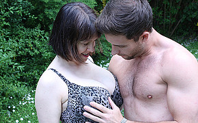 Powerful and handsome guy is touching his babes sweet tits outdoors