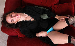 Slutty woman in black dress is happy to demonstrate her blue lingerie