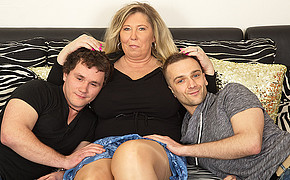 Two lucky guys are laying on this chubby madams extremely big breasts
